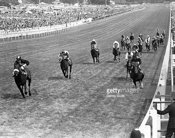 Mill Reef ridden by Geoff Lewis to the left of the picture wins the Epsom Derby