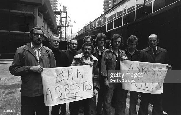 People stage a protest about the dangers of asbestos at the Barbican Arts Centre London