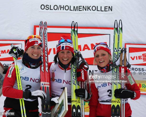2nd Kristin Steira Stoermer of Norway 1st Marit Bjoergen of Norway and 3rd Therese Johaug of Norway show emotions after the women's 30km Cross...