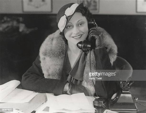 Australian actress Judy Kelly who has just completed her first film 'Money Talks' receives congratulations at Elstree via a long distance phone call...