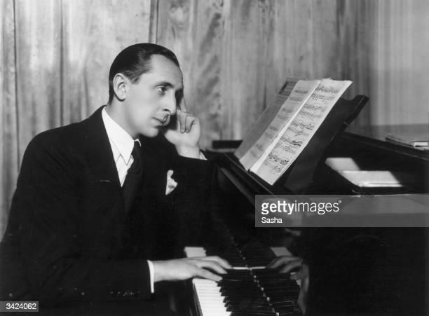 Russian born pianist Vladimir Horowitz strikes a poignant pose at the piano.