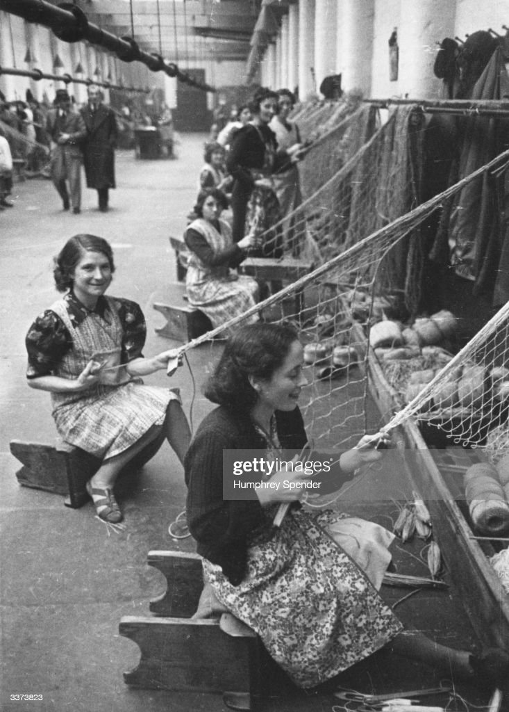 Female workers constructing nets at a Belfast rope factory. Original Publication: Picture Post - 260 - Belfast - pub. 1940