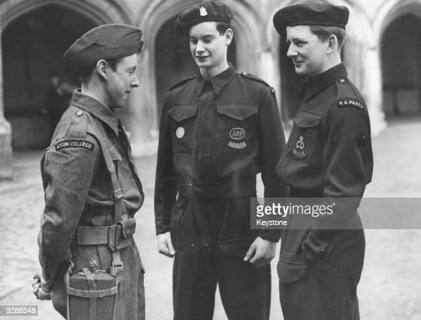 Three pupils at Eton College in ARP uniforms