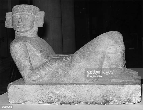 A reclining limestone figure of ChacMool a Mayan rain deity found at ChichenItza in Mexico It is on display at an exhibition of Mexican art at the...