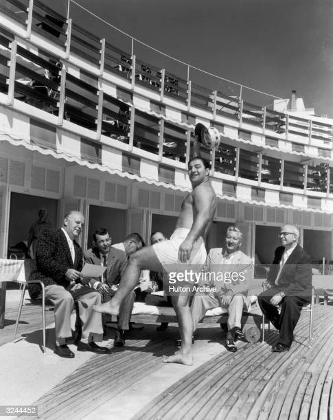 American boxer Rocky Marciano heavyweight champion wears a bathing suit while talking to the press after announcing he would join Jimmy Durante in...