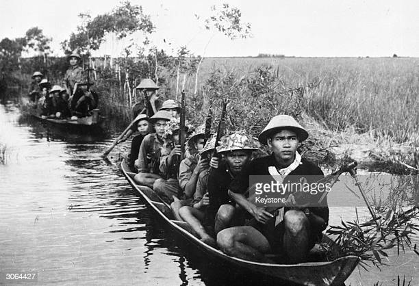 Viet Cong guerillas patrolling a water zone during the Vietnam War.