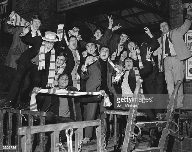Leeds United football supporters waiting for a train