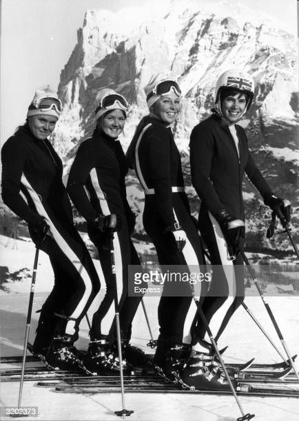 British skiers Valentina Iliffe, Carol Blackwood, Gina Hathorne and Divina Galica of the women's Olympic team pose in a row on a ski slope in...