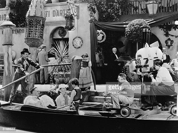 Clarence Brown directs Greta Garbo Fredric March and Freddie Bartholomew in a boating scene for Tolstoy's Russian tragedy 'Anna Karenina'