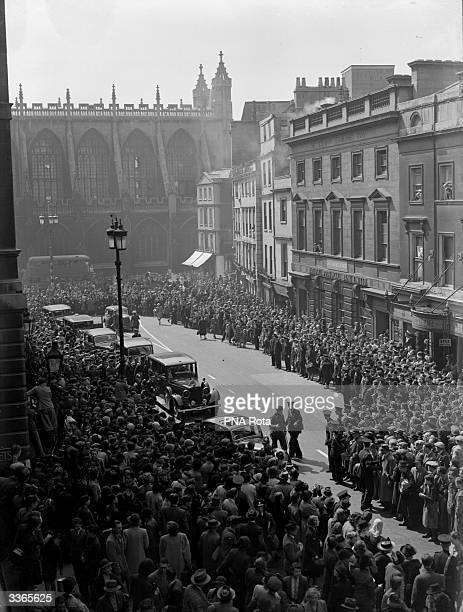 Crowds wait outside the Guildhall to cheer King George VI and his Consort Queen Elizabeth who are paying a surprise visit to Bath following the...