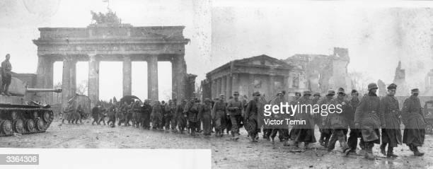 German Prisoners of War in Soviet custody being paraded through Berlin's Brandenburg Gate and past a 'Joseph Stalin' model tank