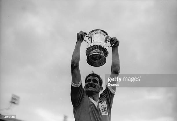 Nottingham Forest Football Club captain Jack Burkitt holds the FA Cup trophy aloft after Forest's 2-1 victory over Luton Town at Wembley.