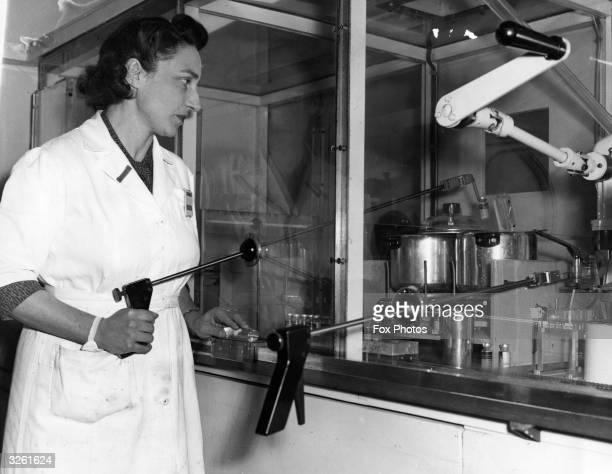 Mrs Elsie Phypers sterilising a bottle of phosphorous at the Laboratory of the UK Atomic Energy Authority Radiochemical Centre at Amersham, Bucks.
