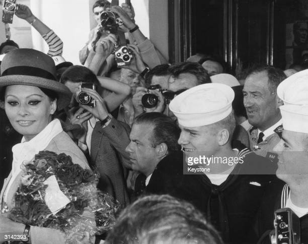 Italian actress Sophia Loren surrounded by a melee of press photographers and admirers as she arrives at Cannes for the film festival and the showing...