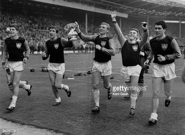 Members of the West Ham United team celebrating after winning the FA Cup final Bobby Moore and John Bond are holding the cup