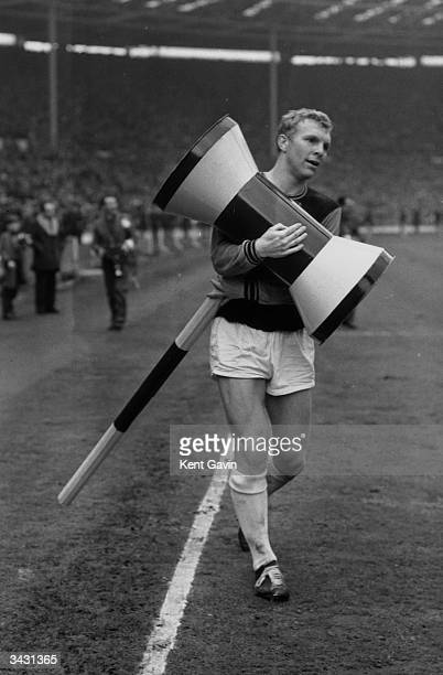 West Ham and England captain Bobby Moore carrying a giant inflatable hammer after West Ham won the FA Cup beating Preston North End 32