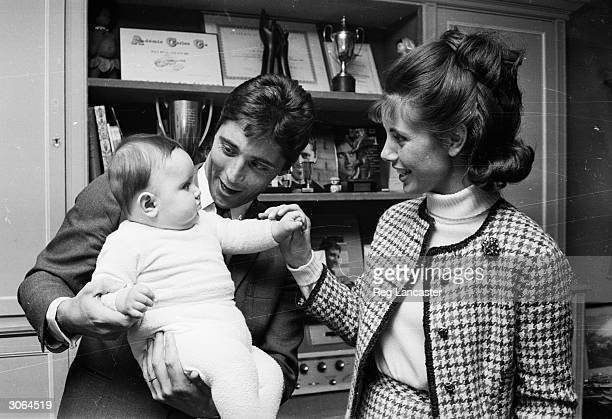 French singer and musician Sacha Distel with his wife Francie Breaud and their baby son Laurent