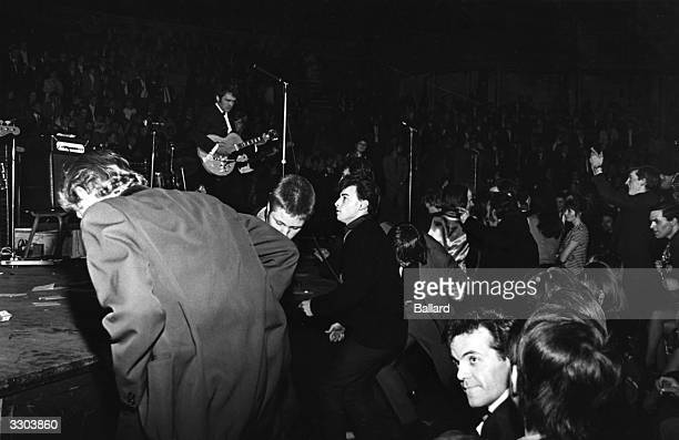 Rock and roll fans enjoying guitarist Duane Eddy's set at the Albert Hall supporting Bill Haley on his visit to England 1968