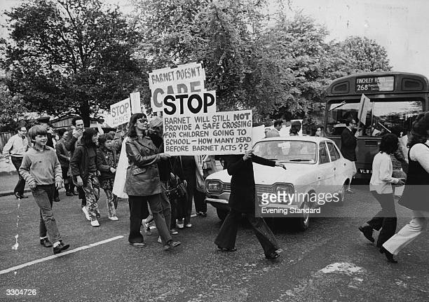 Parents demonstrating outside King Alfreds School North End Road Hampstead for the provision of a children's crossing
