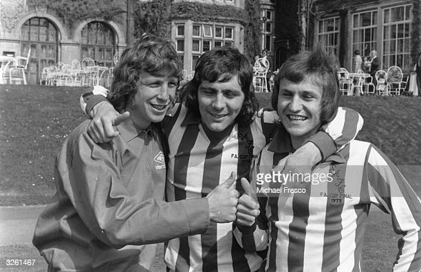 Sunderland players Jimmy Montgomery Ian Porterfield and Dennis Tueart put their thumbs up for the camera three days before their FA Cup Final...