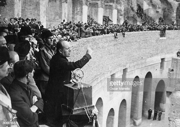 Italian fascist dictator Benito Mussolini speaking at a rally in the coliseum in Rome