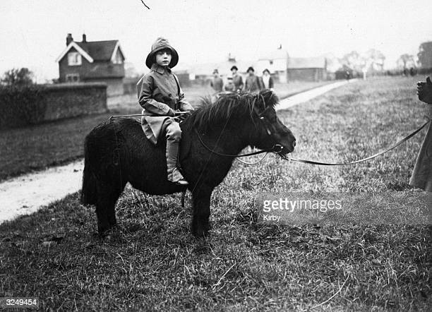 Children interested in equestrian pursuits this one suitably protected from the elements is attending the Bicester Hunt on her Shetland Pony