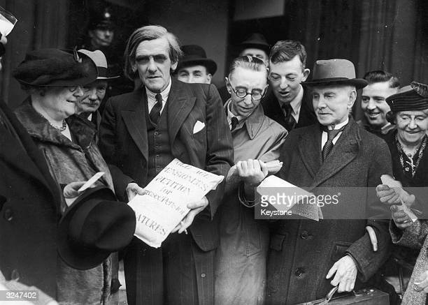 Scottish MP James Maxton talks to Mrs Farr of Halifax who is heading a petition to the House of Commons A cavalcade of taxicabs will convey over four...