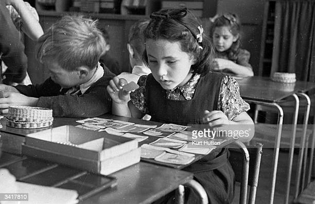 Children develop their problem solving skills by playing games that are both educational and fun, at a Montessori school in Acton, West London....
