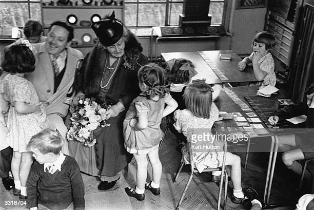 The founder of the Montessori Schools Maria Montessori in a classroom in Acton London with a group of children Original Publication Picture Post 4244...