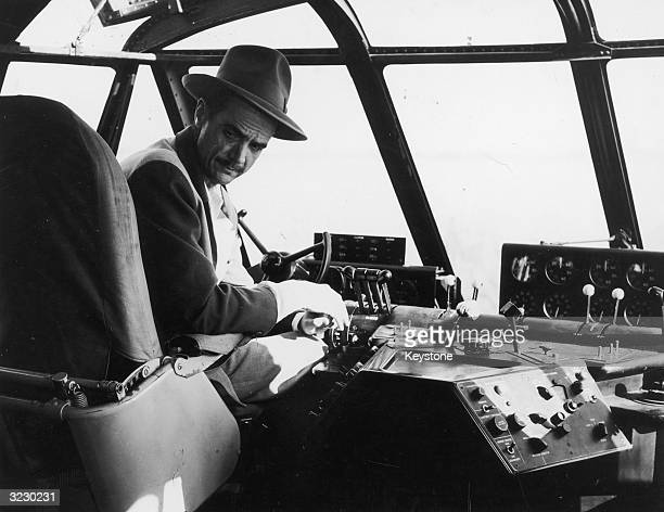 Howard Hughes in the cockpit of his 219 ft flying boat HK1 known as the 'Spruce Goose' on the day scheduled for testing when the plane made its only...