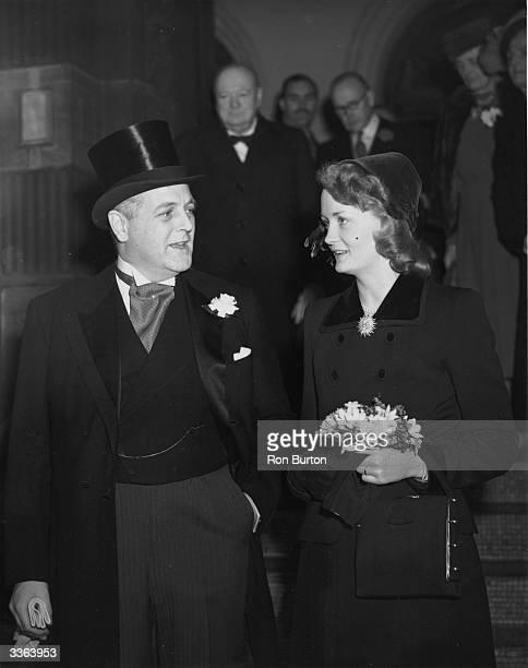 Randolph Churchill, son of Winston Churchill, and June Osborne after their wedding at Caxton Hall.