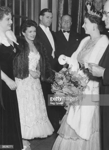 Queen Elizabeth II talks to Anne Shelton and Eve Boswell , members of the cast of 'Guys and Dolls', after the Royal Variety Performance at the London...
