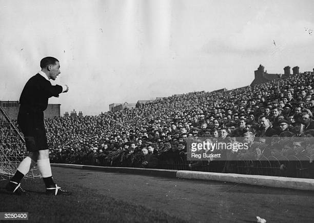 A referee warns the spectators 'any more fireworks and match will be abandoned' as Arsenal play Manchester City at Highbury London