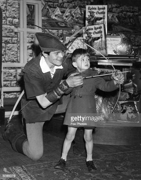 David Clark of Paddington enjoying a lesson in archery from Anthony Moore in Whitleys Store Bayswater Father Christmas is also resident in the store