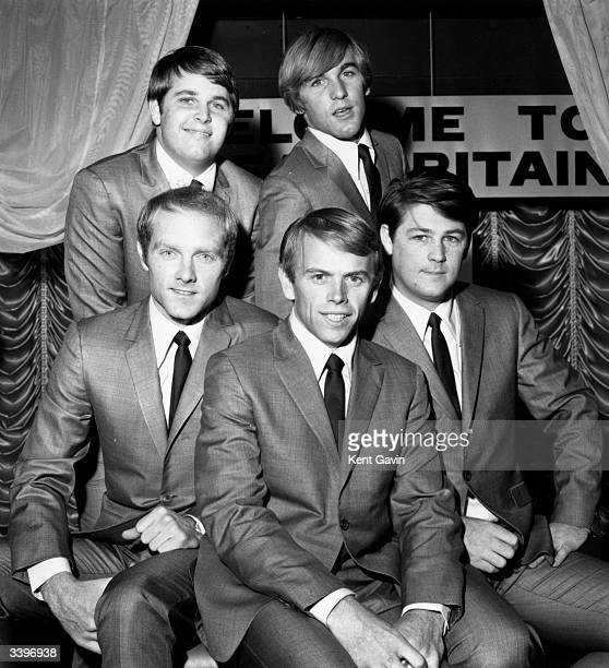 American pop band The Beach Boys, three brothers, one cousin and a schoolfriend, dressed in matching suits and ties, visit Britain to promote their...
