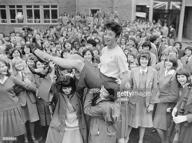 British athlete Ann Packer while working as a PE teacher at Coombe County Girls School after winning the 800 metres at the Tokyo Olympics and setting...