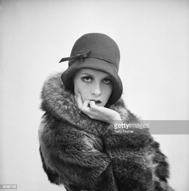 British fashion model Twiggy wearing 1920's style fashions.