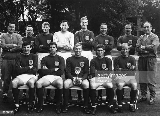 England's triumphant World Cup winning team With the Jules Rimet Trophy are Harold Shepherdson Nobby Stiles Roger Hunt Gordon Banks Jackie Charlton...