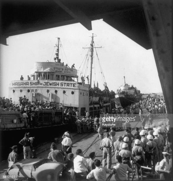 The ship 'Jewish State' docking at Haifa Port with some 2600 refugees on board In the background is the 'Geulah' also loaded with refugees Both ships...