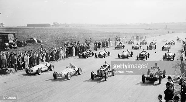The start of the International Grand Prix Race, the first to be held since 1927, at Silverstone. It was won by Villoresi of Italy driving for...