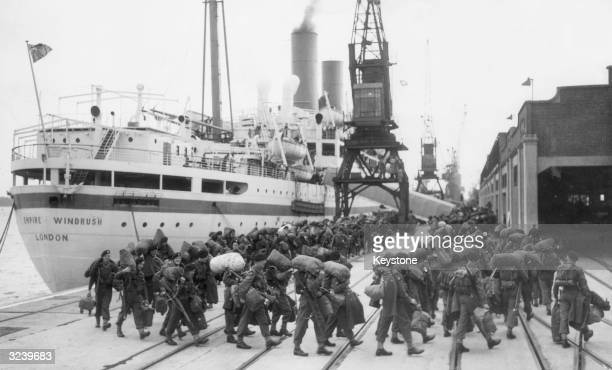 Men of the Gloucester Regiment the Royal Engineers and the Royal Armoured Corps board the SS Empire Windrush at Southampton bound for Korea