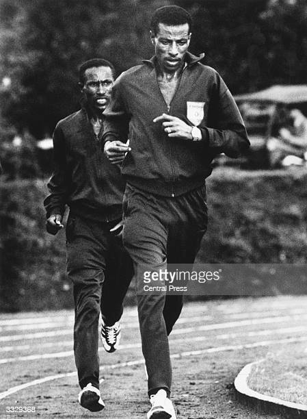 Ethiopian long distance runner Abebe Bikila in training for the Olympics at Tokyo with his marathon team mate Mamo Wolde. Bikila won the Gold medal.