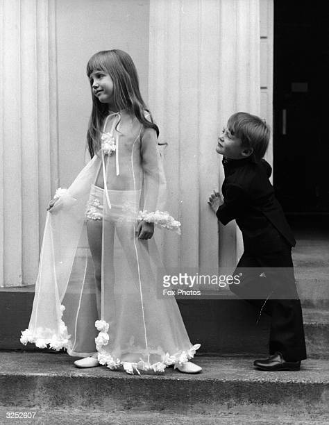 Sixyearold Yasmin models a seethrough negligee in silk organza which caught the eye of Justin aged 5 who was wearing a navy suit with bellbottomed...