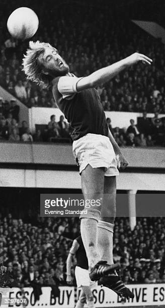 West Ham United football player Billy Bonds in action