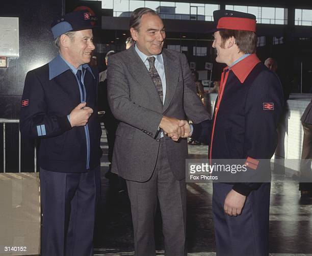 Sir Peter Parker , Chairman of British Rail meets a couple of British Rail workers.