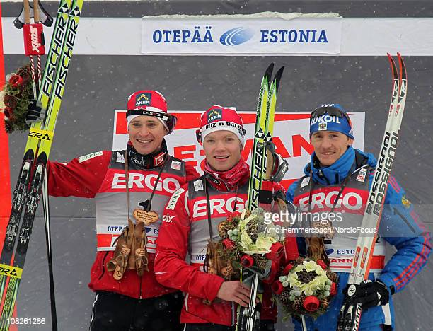 2nd Ola Vigen Hattestad of Norway 1st Eirik Brandsdahl of Norway 3rd Nikita Kriukov of Russia pose after the men's individual sprint Cross Country...