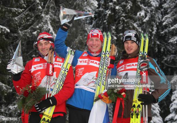 2nd Petter Northug of Norway 1st Lukas Bauer of Czech Republic and 3rd Dario Cologna of Switzerland celebrate their success during the final climb...