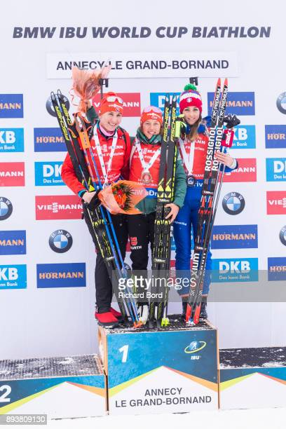 2nd place Anastasiya Kuzmina of Slovakia, 1st place Laura Dahlmeier of Germany and 3rd place Lisa Vittozzi of Italy pose on the podium after the IBU...