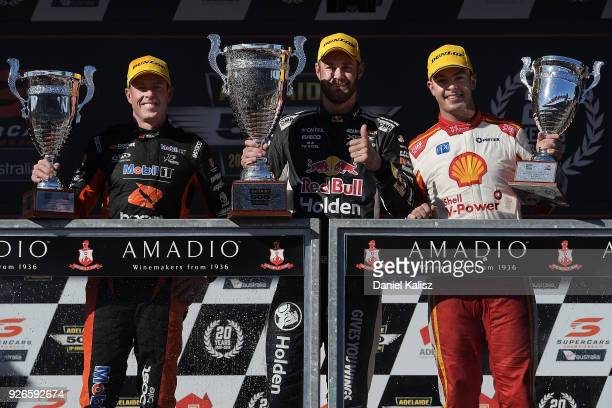 2nd place James Courtney driver of the Mobil 1 Boost Mobile Racing Holden Commodore ZB 1st place Shane Van Gisbergen driver of the Red Bull Holden...
