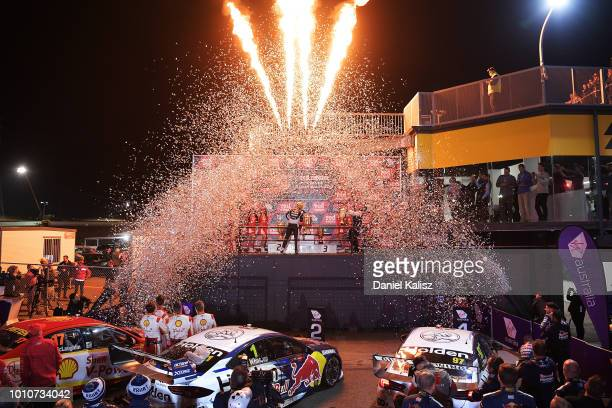 2nd place Jamie Whincup driver of the Red Bull Holden Racing Team Holden Commodore ZB celebrates on the podium after race 21 for the Supercars Sydney...